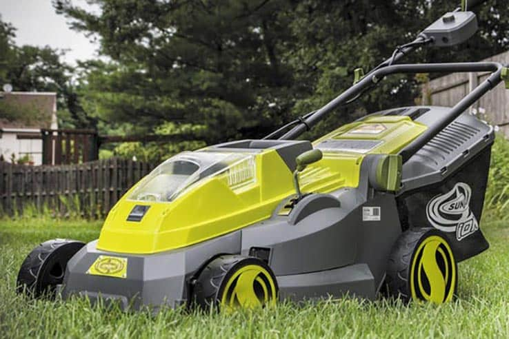 sun joe ion mower with brushless mower sitting on grass