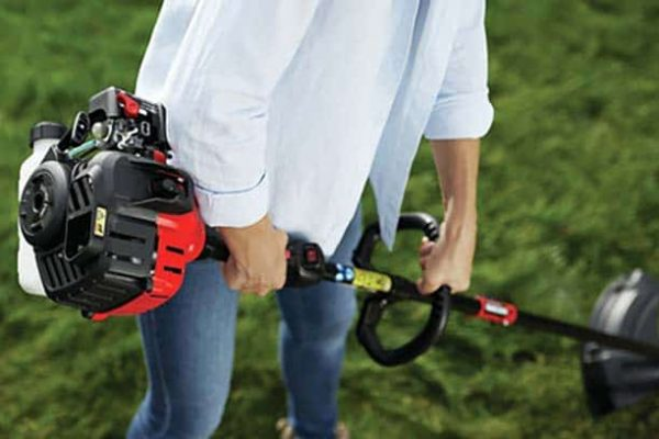 woman using 4 cycle Craftsman WS405 weed eater